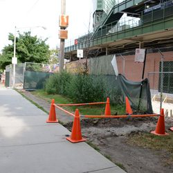 5:31 p.m. More work being done, along the Waveland Avenue sidewalk -