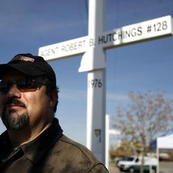 Brian Hutchings of Payson stands at the cross dedicated to his father at the UHP building in Murray  on Wednesday, Nov. 16, 2011. Hutchings spoke at a town hall meeting about the controversy surrounding the UHP memorial crosses.