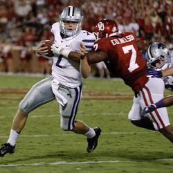 Kansas State quarterback Collin Klein (7) is stopped by Oklahoma linebacker Corey Nelson (7) during the second quarter of an NCAA college football game in Norman, Okla., Saturday, Sept. 22, 2012.