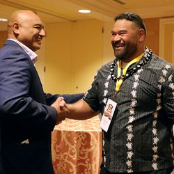 Rich Kaufusi shakes hands with NFL football player Haloti Ngata before Ngata is honored at the Utah Sports Hall of Fame banquet at the Little America Hotel in Salt Lake City on Monday, Sept. 20, 2021.