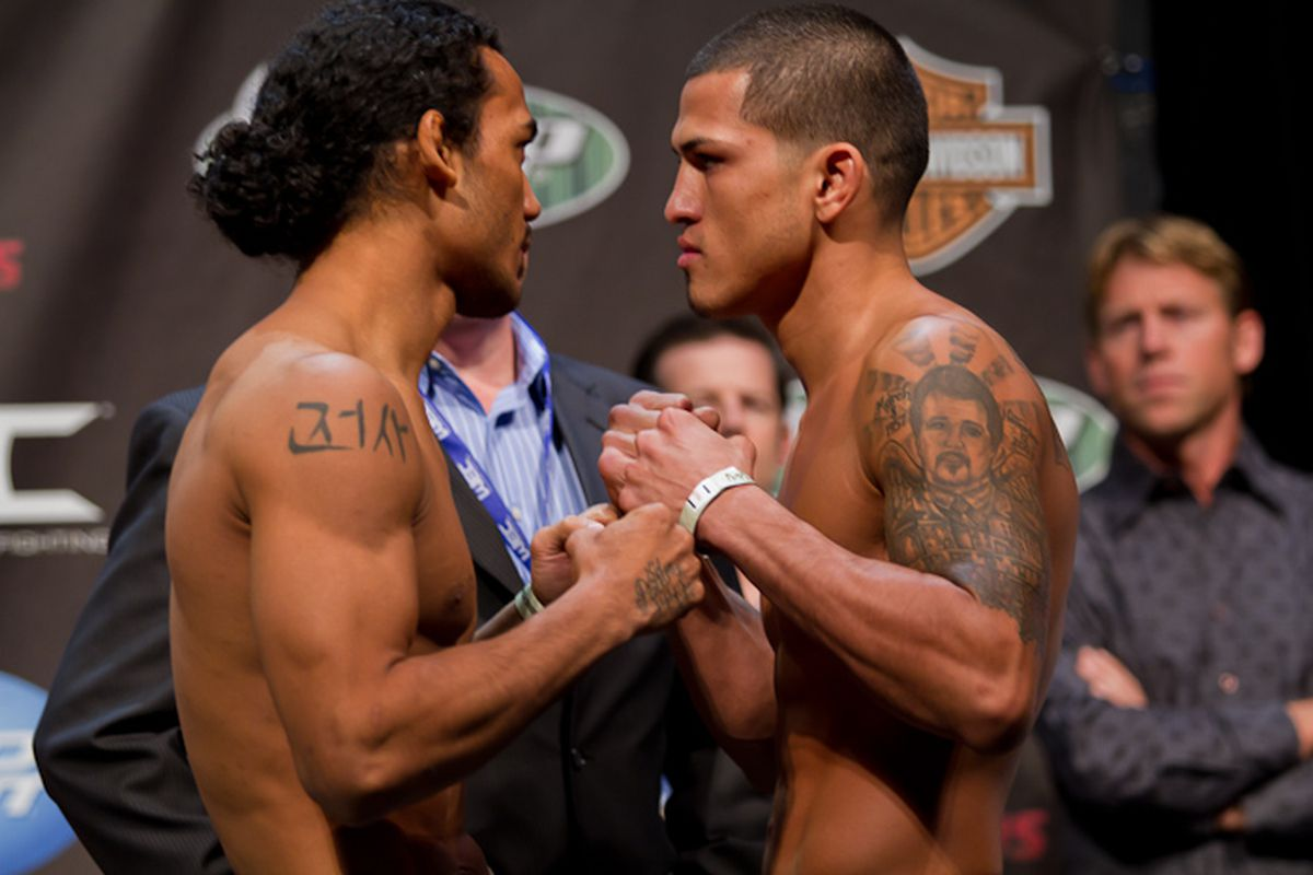 WEC lightweight champion Benson Henderson and challenger Anthony Pettis square off at Wednesday's weigh-ins. Photo by Ryan Malone.