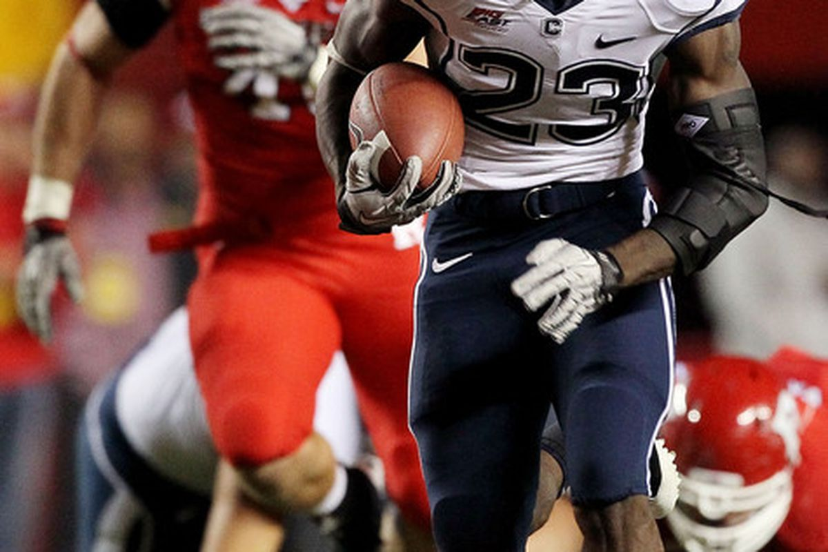 PISCATAWAY, NJ - OCTOBER 08:  Jordan Todman #23 of the Connecticut Huskies runs for a second-quarter touchdown against the Rutgers Scarlet Knights at Rutgers Stadium on October 8, 2010 in Piscataway, New Jersey.  (Photo by Jim McIsaac/Getty Images)