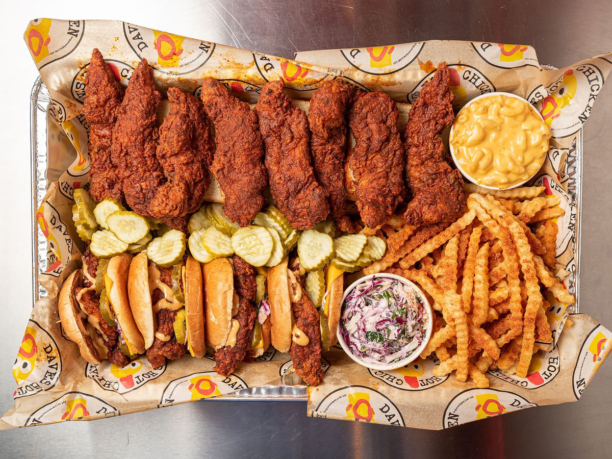 A lineup of chicken tenders and sandwiches with fries and sides.