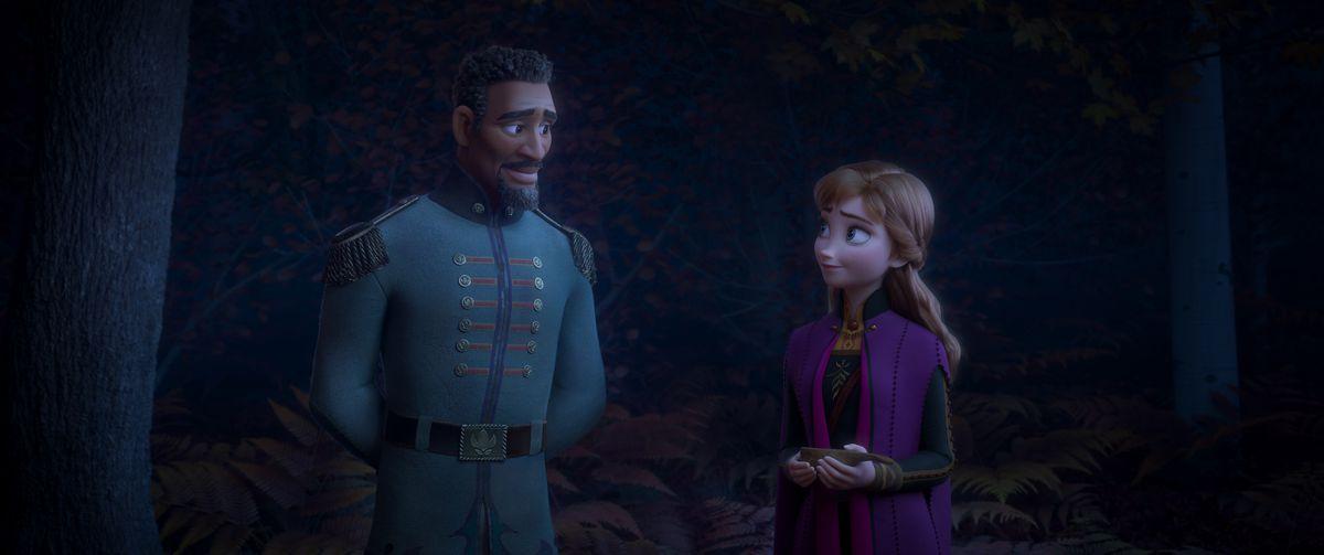 Lieutenant destin mattias, a tall dignified black man in uniform, talks to Princess Anna in a darkened forest