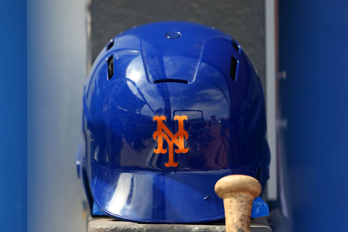 A New York Mets batting helmet in the dugout before a spring training baseball game against the Houston Astros at Clover Park on March 8, 2020 in Port St. Lucie, Florida.