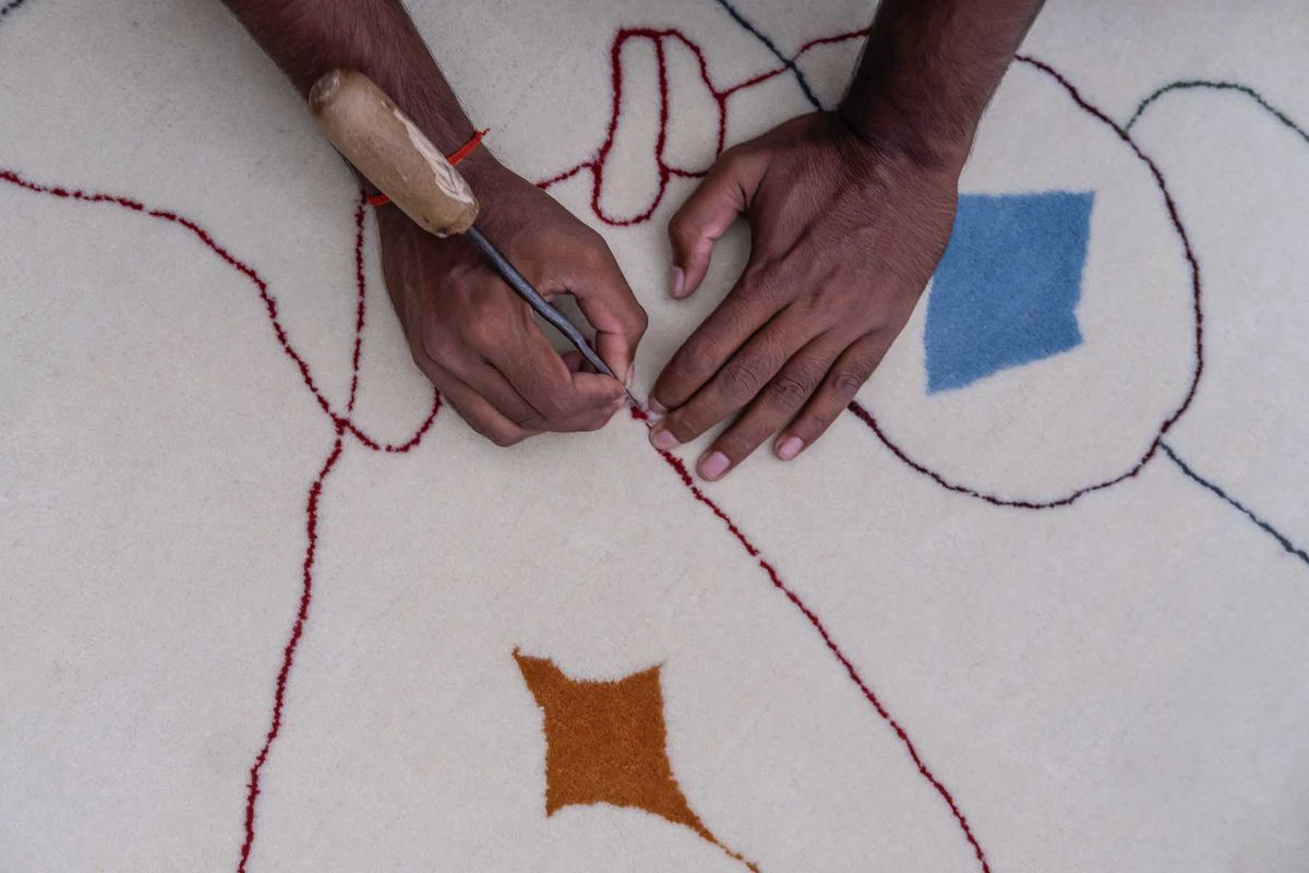 Close up of hand embroidering pattern.