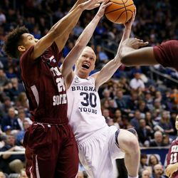 Brigham Young Cougars guard TJ Haws (30) bounces off of Texas Southern Tigers guard Cainan McClelland (20) on a drive to the hoop as BYU and Texas Southern play an NCAA basketball game in Provo at the Marriott Center on Saturday, Dec. 23, 2017. BYU won 73-52.
