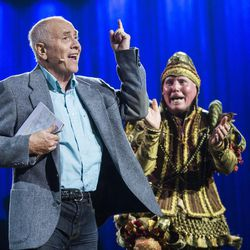 """James C. Christensen, left, performs at BYU's Homecoming Spectacular, """"Take Flight,"""" with the popular Everyman character he created, played by H. Patrick Debenham, on Oct. 15, 2014."""