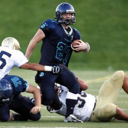 Juan Diego's Jessie Springer (27) gets tackled by Skyline's Andre Salehi (25) during the first half on Friday.