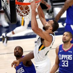 Utah Jazz center Rudy Gobert (27) dunks over LA Clippers forward Serge Ibaka (9) as the Utah Jazz and LA Clippers play in an NBA basketball game at Vivint Smart Home Arena in Salt Lake City on Friday, Jan. 1, 2021.
