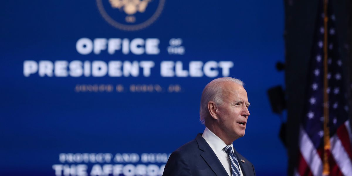 "Joe Biden speaks at a podium in front of a backdrop reading, ""Office of the President-elect"""