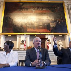 Massachusetts Gov. Deval Patrick, right, sits on a panel with Chairman of Partners HealthCare Jack Connors, center, and health care client Mona Rudolph, left, at Faneuil Hall in Boston, Wednesday, April 11, 2012. Gov. Patrick and the other participants were celebrating the sixth anniversary of Massachusetts' landmark health care law that was signed by former Gov. Mitt Romney at Faneuil Hall in 2006.