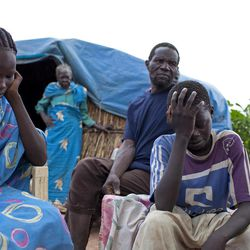 In this photo taken Sunday, Sept. 16, 2012, Zeinab Abdallah Kuwa, 18, left, and Abdul Karim Mustafa, 15, right, recount their experience of being bombed by airplanes as they fled from their home in Tuna in Sudan's South Kordofan State, to their new home in Yida refugee camp, South Sudan. Newly arrived refugees at the camp along the volatile South Sudan-Sudan border say renewed fighting between rebels and Sudan's military is likely to send thousands more people to the expanding camp there filled with refugees of war and hunger.