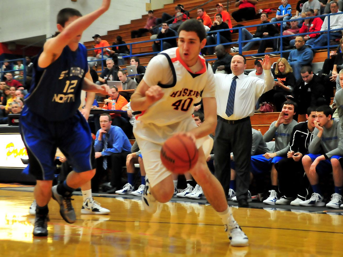 Oak Park's Gabe Levin moves to the hoop past Quinten Payne of St. Charles North in 2011.
