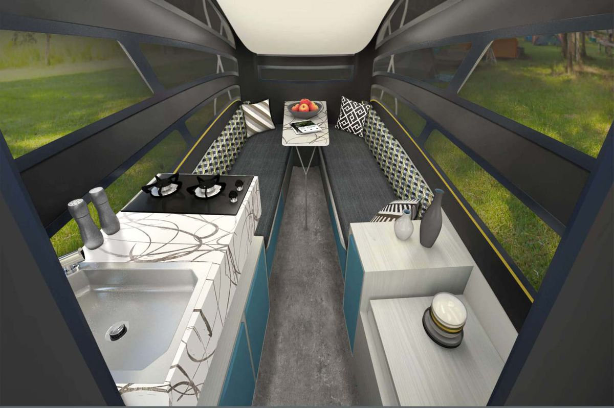 An interior rendering of the trailer has a white kitchen with swirly countertops, and a rear gray bench area.
