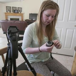 Megan Palmer checks out her gear while at home Wednesday, March 6, 2013. Megan and her cousin Jenica Woolley worked produced a short film discussing Albinism.