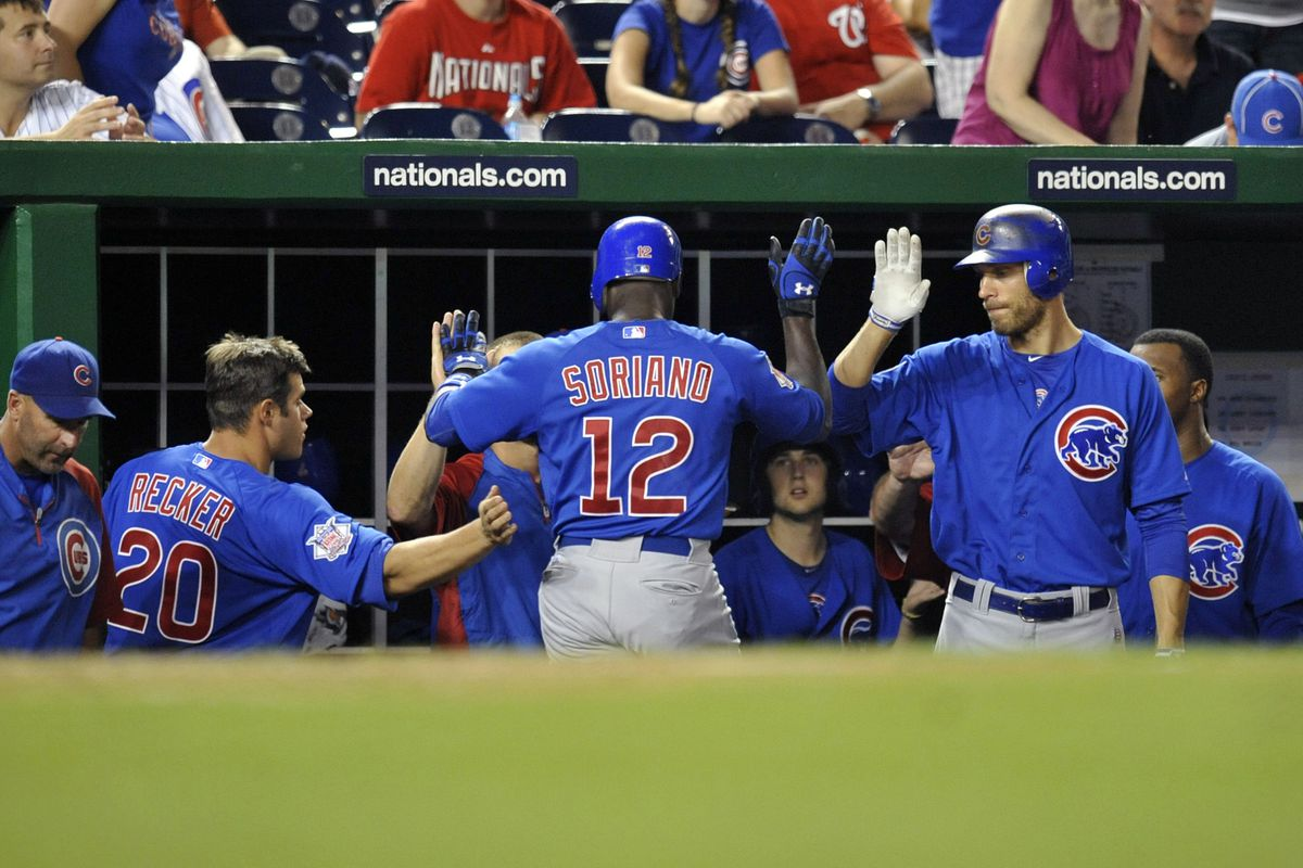 Washington, D.C., USA; Chicago Cubs left fielder Alfonso Soriano is congratulated by teammates after hitting a solo home run against the Washington Nationals at Nationals Park. Credit: Joy R. Absalon-US PRESSWIRE