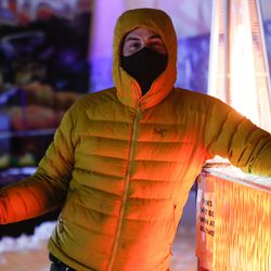 """Bo Dean poses for a portrait with his project """"The Glow Bar"""" at Lumen Land in Salt Lake City on Monday, Nov. 9, 2020."""