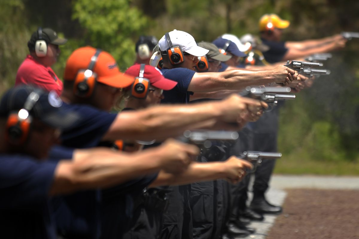 Police recruits at target practice.