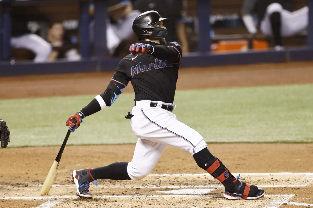 Isan Diaz of the Miami Marlins hits a grand slam during the third inning against the Milwaukee Brewers at loanDepot park