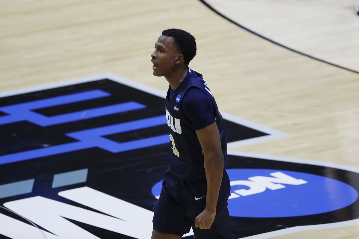 Oral Roberts Golden Eagles guard Max Abmas celebrates after making a three point basket against the Ohio State Buckeyes during the first half in the first round of the 2021 NCAA Tournament at Mackey Arena.