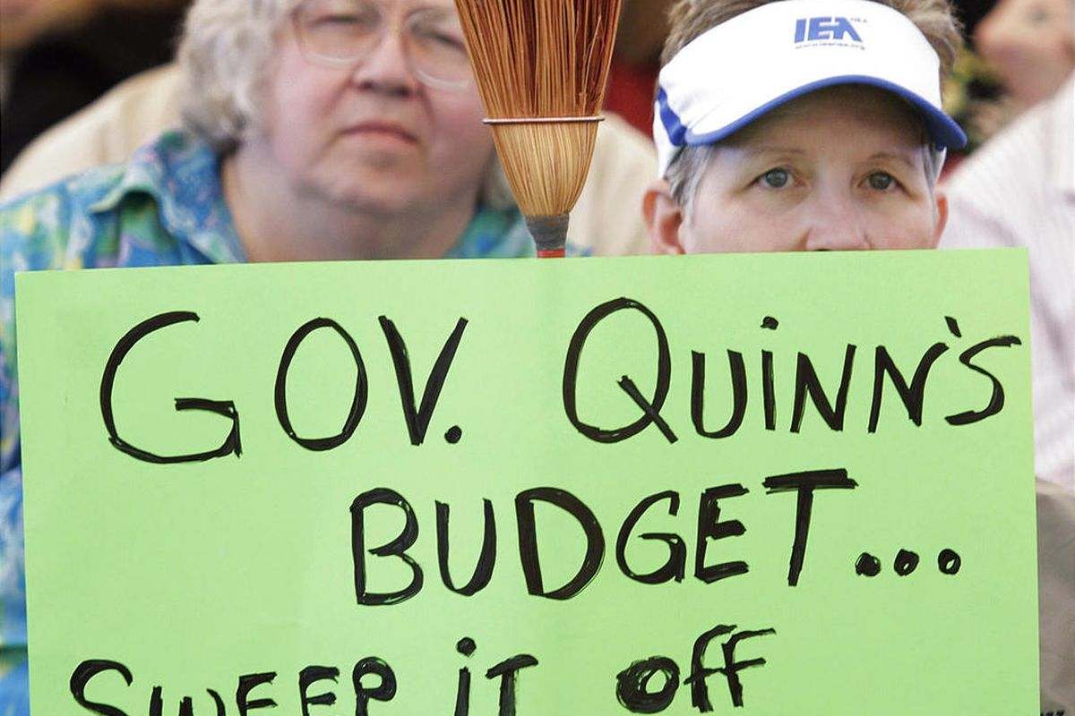 Teacher Carrie Cox from Andrew High School in Tinley Park, Ill., protests along with other teachers opposing Illinois Gov. Pat Quinn's budget cuts and new pension plan.
