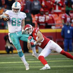 Miami Dolphins tight end A.J. Derby (85) is tackled by Kansas City Chiefs defensive back Daniel Sorensen (49) during the second half of an NFL football game in Kansas City, Mo., Sunday, Dec. 24, 2017. The Kansas City Chiefs won 29-13. (AP Photo/Charlie Riedel)
