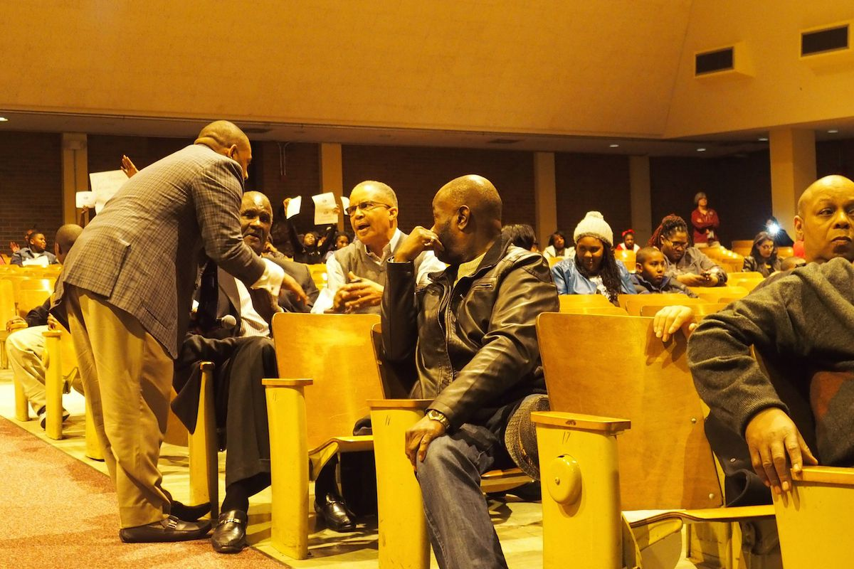 Shelby County School Board member Kevin Woods talks with a community member during a forum Monday night to discuss proposed school closures in a southwest Memphis neighborhood.