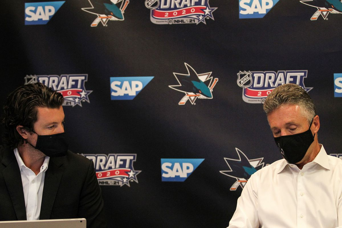 SAN JOSE, CA - OCTOBER 06: San Jose Sharks General Manager Doug Wilson and Director of Scouting Doug Wilson Jr. prepare before Round One of the 2020 NHL Draft on October 6, 2020 at SAP Center in San Jose, California. The 2020 NHL Draft was held virtually due to the ongoing Coronavirus pandemic.