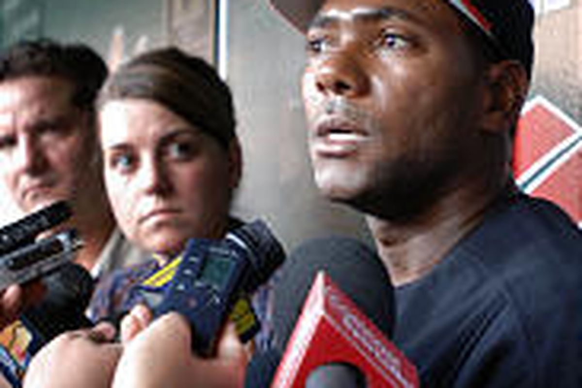 Baltimore's Miguel Tejada answers questions regarding Rafael Palmeiro from reporters before a recent game.