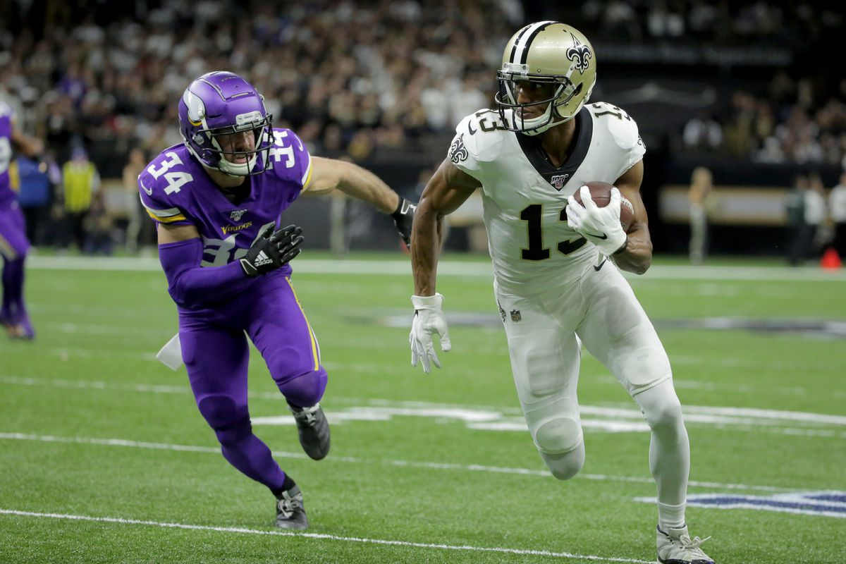New Orleans Saints wide receiver Michael Thomas runs after a pass reception against Minnesota Vikings strong safety Andrew Sendejo during the first quarter of a NFC Wild Card playoff football game at the Mercedes-Benz Superdome.