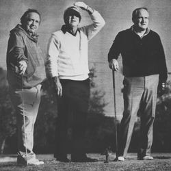 Former BYU football coach LaVell Edwards, right.
