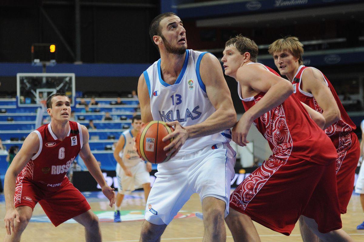 Timofey Mozgov defending NBA teammate Kostas Koufos during the EuroBasket 2011.
