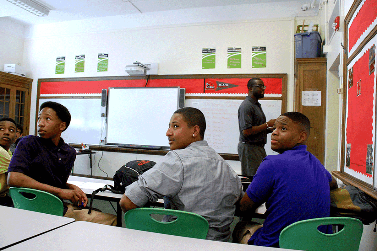 Freshmen at DSST Cole High School in Dexter Korto's morning advisory class look to the back of the class where English standards are posted.