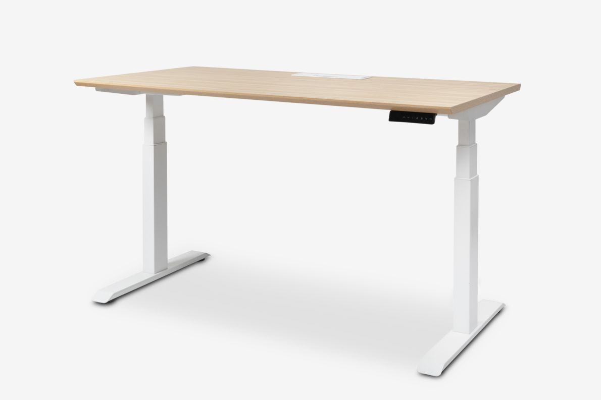 Light wood standing desk with white legs.