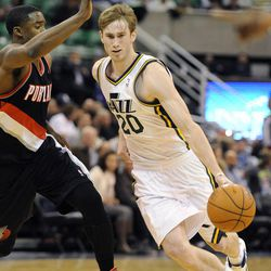 Utah Jazz small forward Gordon Hayward (20) drives around the defense of Portland Trail Blazers shooting guard Wesley Matthews (2) in the second half of a game at the Energy Solutions Arena on Wednesday, October 16, 2013.