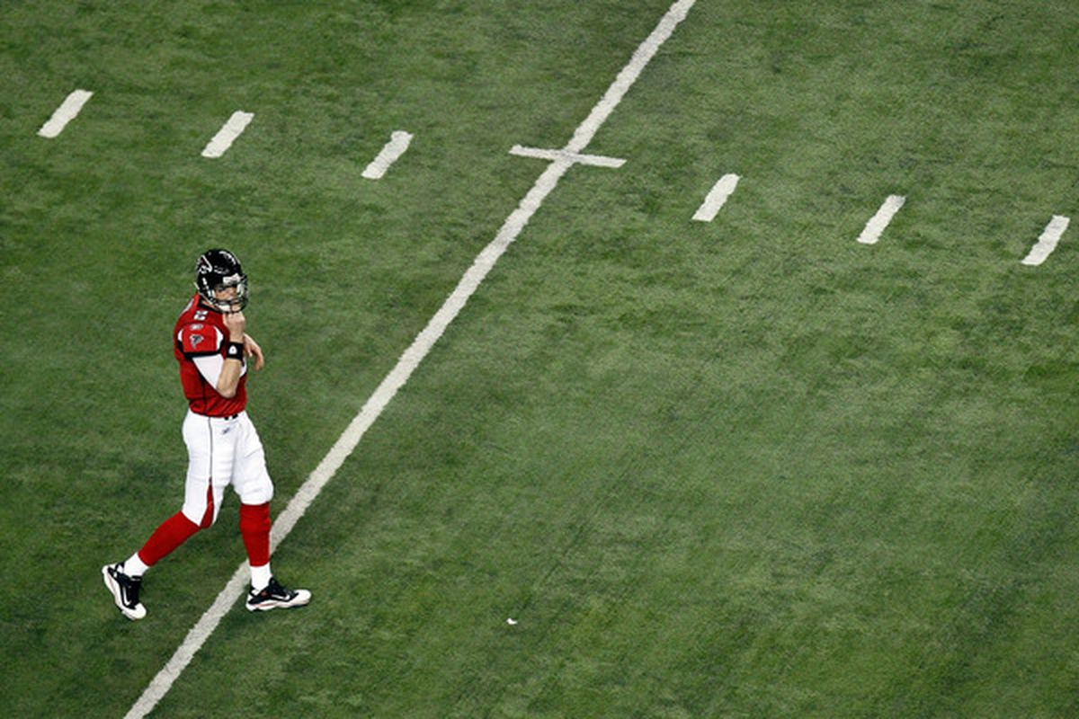 ATLANTA GA - JANUARY 15:  Matt Ryan #2 of the Atlanta Falcons walks on the field against the Green Bay Packers during their 2011 NFC divisional playoff game at Georgia Dome on January 15 2011 in Atlanta Georgia.  (Photo by Kevin C. Cox/Getty Images)