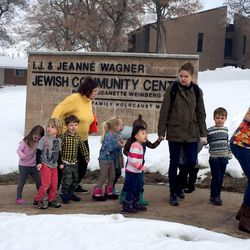 Members of the Jewish Community Center in Salt Lake City evacuate the facility after a bomb threat on Tuesday, Jan. 31, 2017.