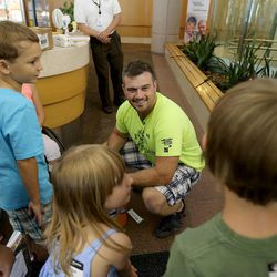 Former USMC Sgt. Jay Knight meets with patients at Shriners Hospital for Children Monday, July 28, 2014. He is bicycling across the country in honor of Lance Cpl. Johnny Strong who was killed while serving in Iraq. Knight and his co-rider, Denny Salisbury, started their journey April 1, in Boston.