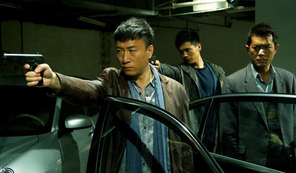 Sun Honglei as police captain Zhang Lei pointing a pistol in Drug War (2012)