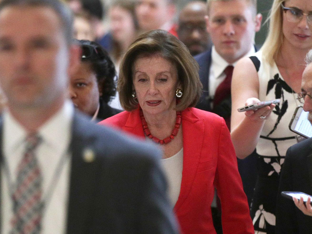 Speaker of the House Nancy Pelosi walks towards the House chamber for a vote on the border supplemental aid package on Thursday.