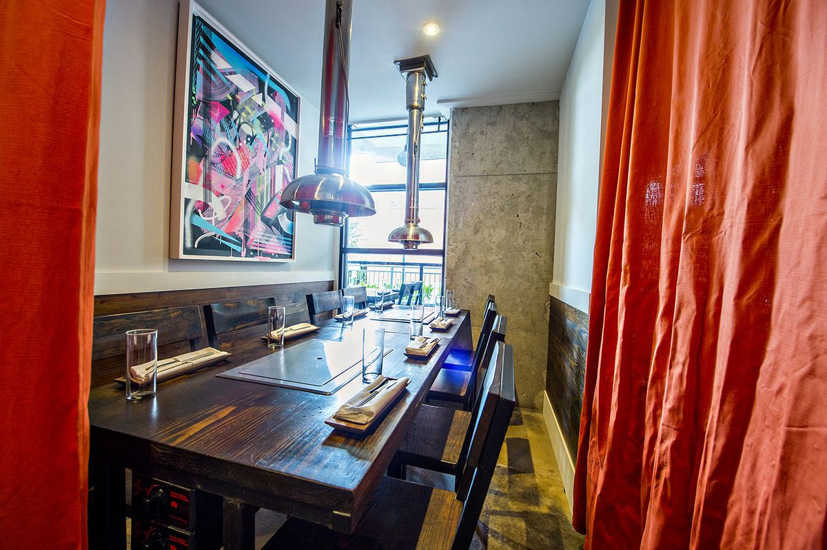 A semi-private table near the bar that has curtains to allow a more intimate dining experience.