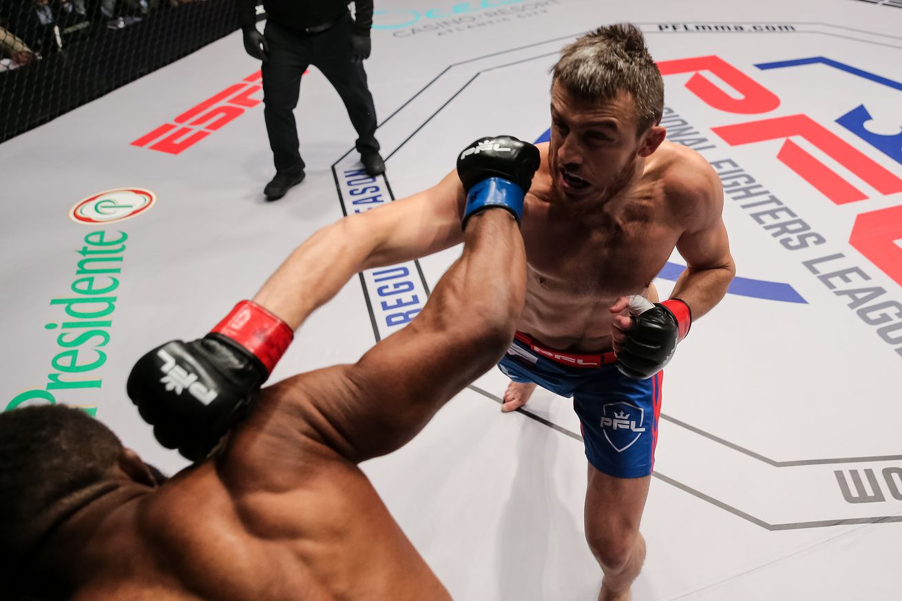 Magomed Magomedkerimov throws a punch at Chris Curtis in the welterweight main event of PFL 4 in Atlantic City, New Jersey, on Thursday