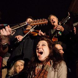 """Demonstrators sympathetic to the Occupy Wall Street protests sing at a brief acoustic concert featuring activist musician Pete Seeger, not shown, in Columbus Circle, Saturday, Oct. 22, 2011, in New York. The demonstrators marched down Broadway singing """"This Little Light of Mine"""" and other folk and gospel songs while ad-libbing lines about corporate greed and social justice."""