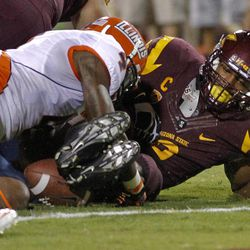 Illinois defensive back Patrick Nixon-Youman (4) dives on Arizona State running back Cameron Marshall (6) as Marshall fumbles near the goal line during the first half of an NCAA college football game, Saturday, Sept. 8, 2012, in Tempe, Ariz.