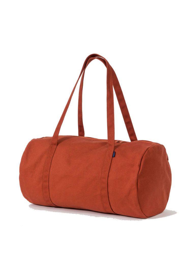 A rust-colored duffel bag