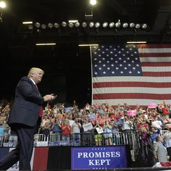 President Donald Trump arrives on stage to speak at the U.S. Cellular Center in Cedar Rapids, Iowa, Wednesday, June 21, 2017. This is Trump's first visit to Iowa since the election.