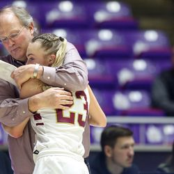 Cedar's head coach Corry Nielsen hugs guard Mayci Torgerson (23) with a few minutes left in the fourth quarter during the 4A girls championship basketball game against Pine View at the Dee Events Center in Ogden on Saturday, Feb. 29, 2020.