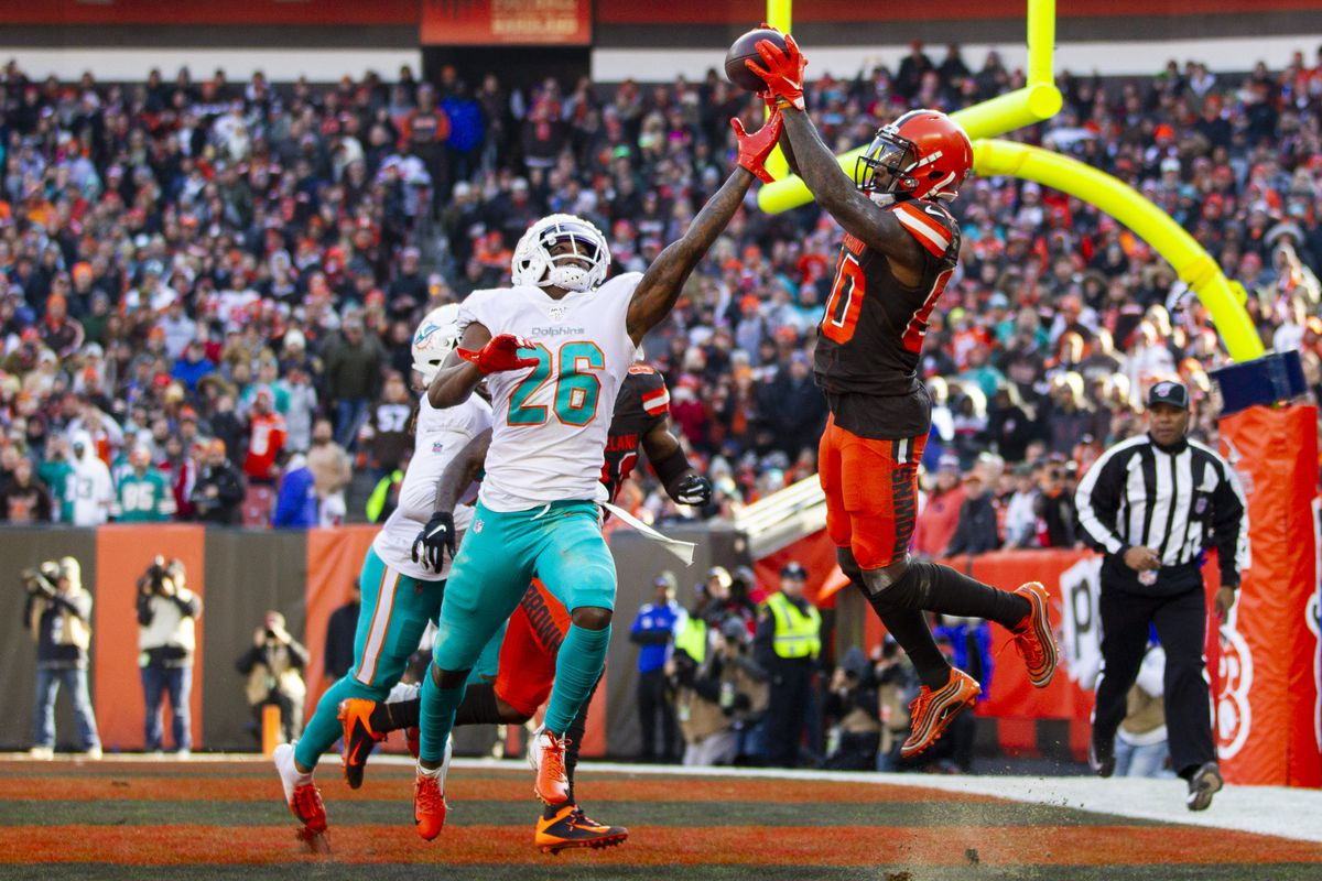 Cleveland Browns wide receiver Jarvis Landry makes a reception for a touchdown as Miami Dolphins defensive back Steven Parker reaches for the ball during the second quarter at FirstEnergy Stadium.