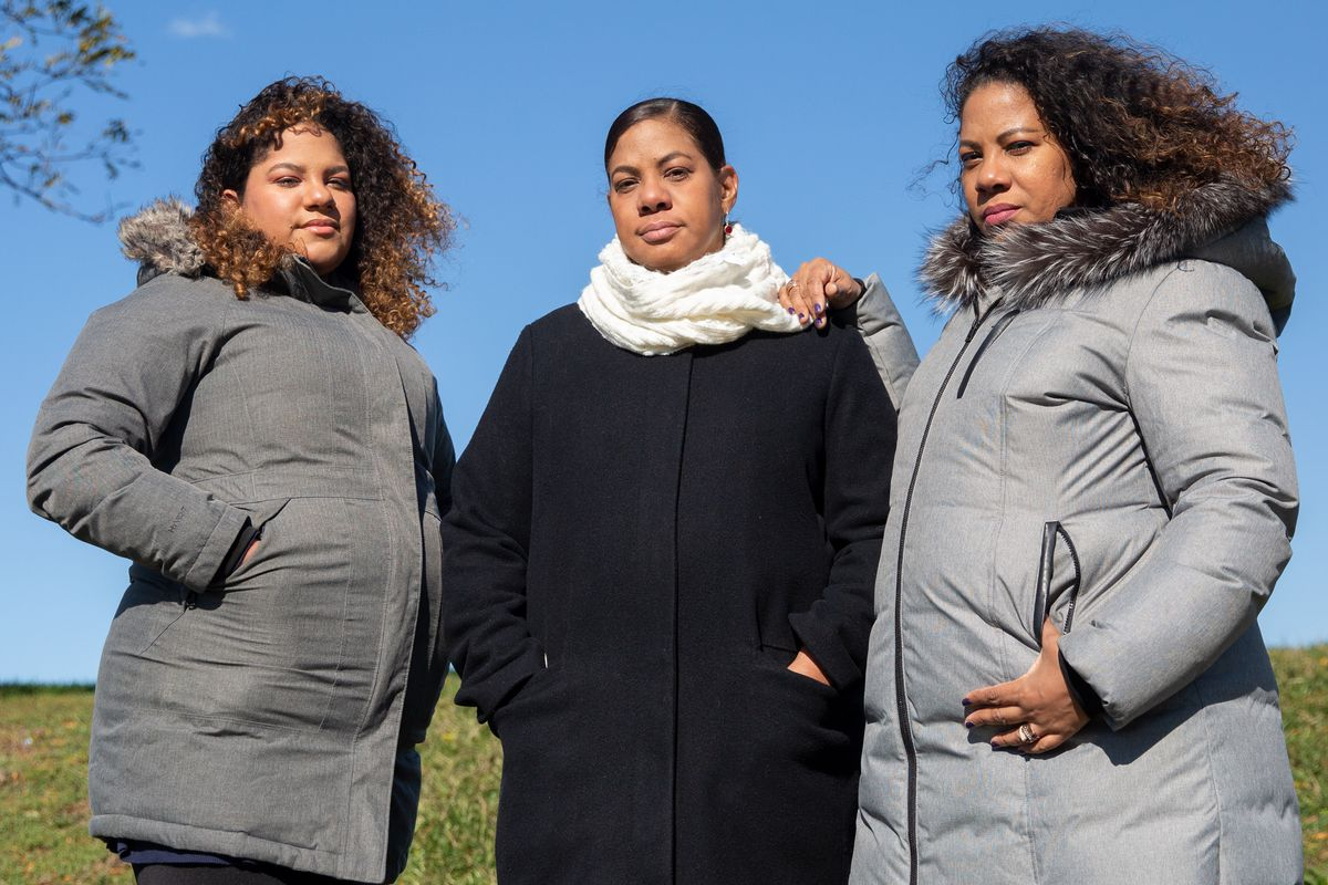 Family members Kaitlin Viera, left, Ivonne Davila and Ivette Davila-Richards have been forced out of their Sunset Park home since the building caught fire a year and half ago.